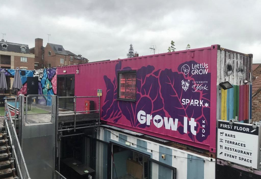 Image of the exterior of a container housing a vertical farm in Spark York