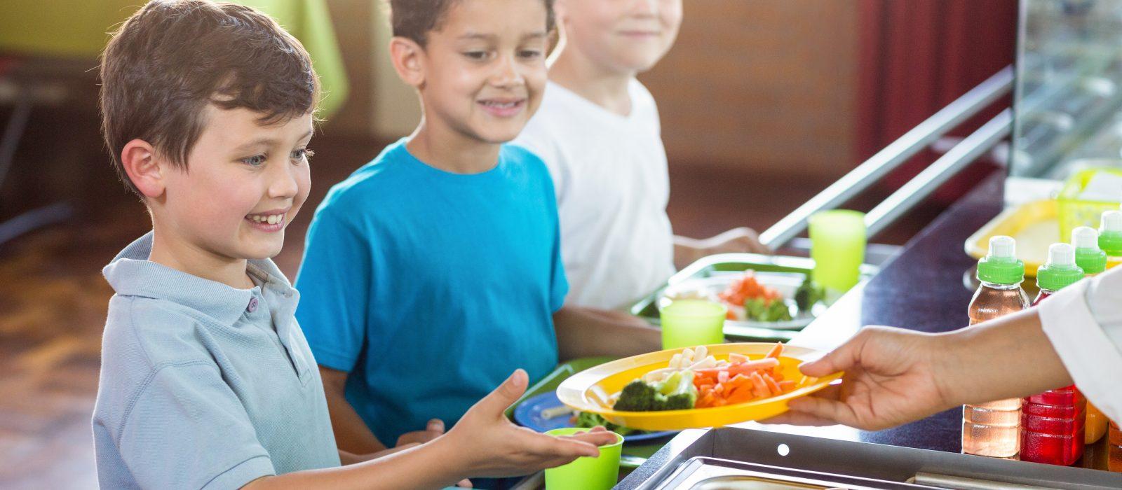 Image of children receiving a healthy school lunch