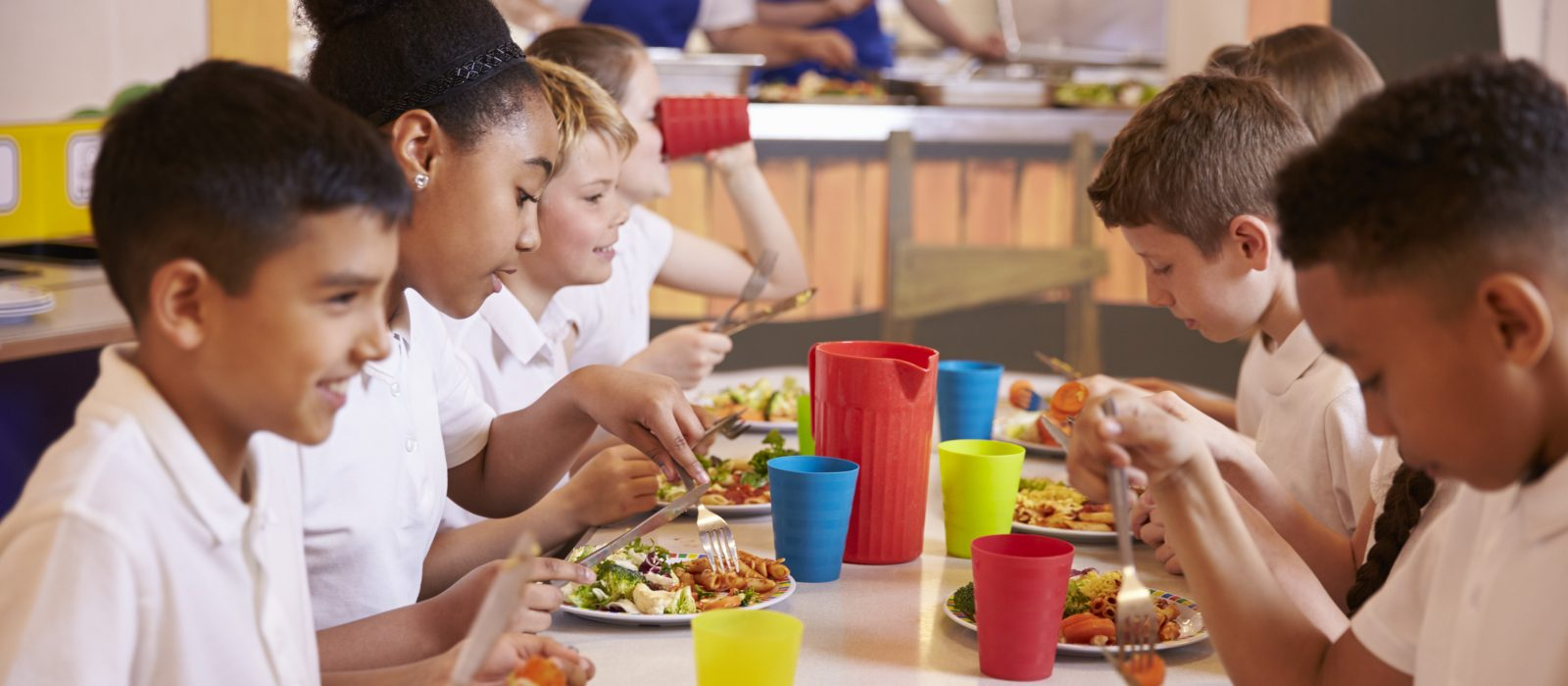 Image of primary school children eating lunch together at a table